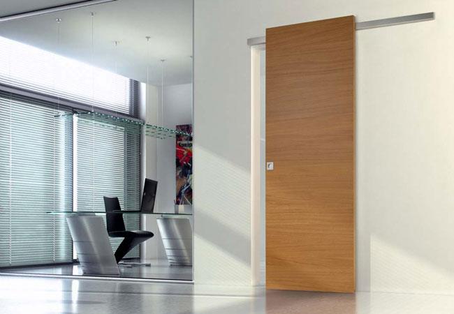 Porta a battente o porta scorrevole rifare casa - Porta garage scorrevole ...